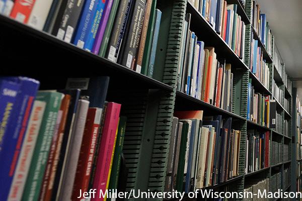 Books on shelves at Memorial LIbrary, UW-Madison