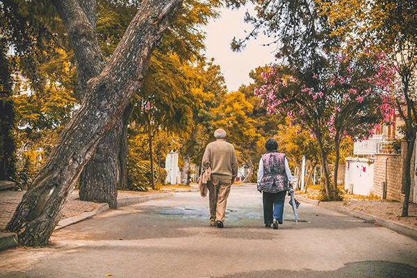 An older couple takes a walk on a nice day