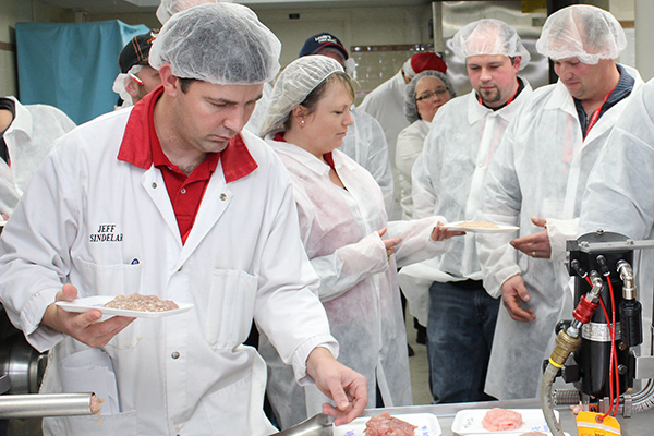 people testing meat products