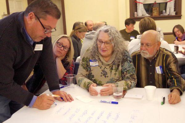 A community development educator leads a team through an activity.