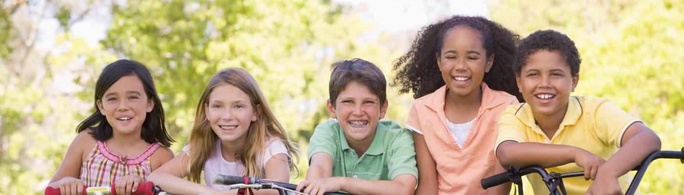 Five children with their bikes