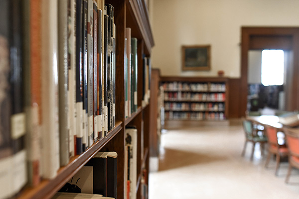 Books on a shelf in a library.