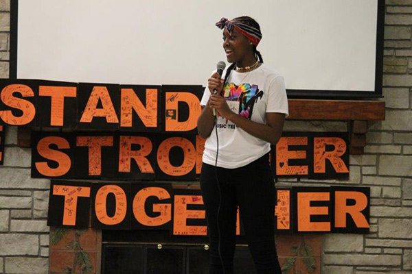 Young person standing giving a speech